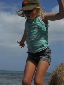 Young girl jumping in the air